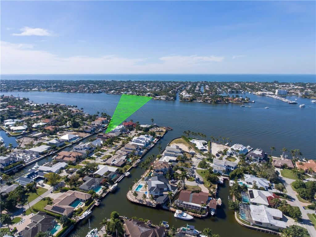 Far and few between. Only 3 doors from wide open views on Naples Bay. Most desirable southern exposure, nice quiet cul-de-sac location, & sunsets from your backyard Bay view. Boaters will appreciate the rough tide protected canal boat dock, far distance from boat traffic, non-bridge access to Gulf, & deep waters. Concrete block structure allows new Owner to renovate the old Florida home or build their dream home. Dolphin Court offers minimal car traffic & only a short walking distance to downtown 5th Avenue. Don't miss this rare opportunity.