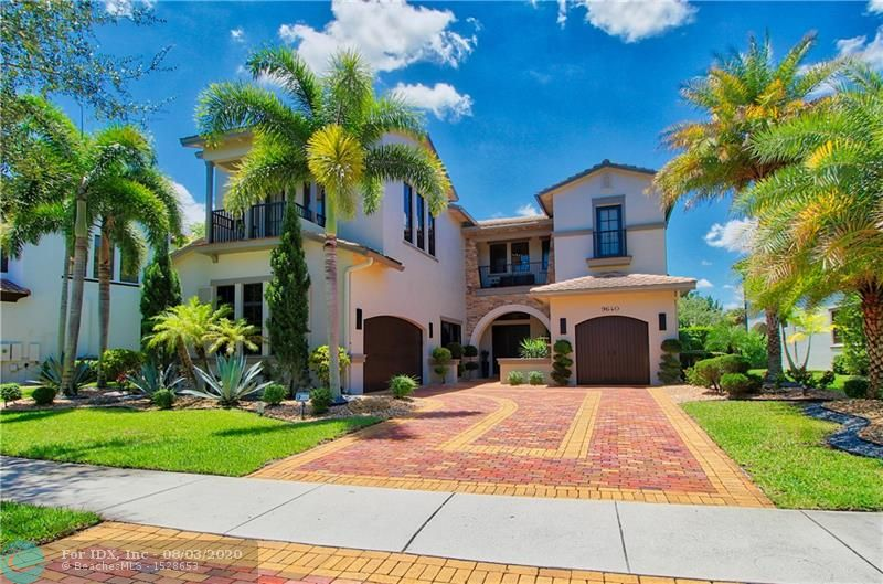 This Parkland Golf San Savino model has been completely renovated from top to bottom with the most exquisite taste featuring a sleek and monochromatic design which many refer to as modern chic. The fully remodeled kitchen features tall solid wood cabinetry, quartz countertops, a butlers pantry, double islands, under cabinet lighting and brand new SS appliances, including new cook top, sink and disposal. Spectacular lighting features Italian glass pendants, beautiful sconces and gorgeous chandeliers throughout. NO carpet throughout entire home, full travertine first floor with full wood up, media room features cork flooring for sound resistance. Fully customized pool features sun shelf, travertine decking, water features and LED lighting and is paired with a phenomenal outdoor kitchen.