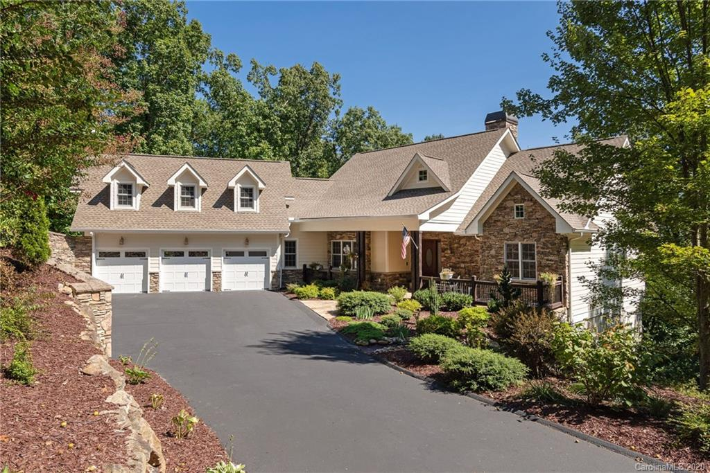 Uncommon elegance and hard to find features for your mountain retirement home . Level driveway, 3-car garage, full bath for each bedroom ( 4 ), natural gas generator and supremely private make this home exceptional and unique.Open floor plan with 4BD/4.5BTH.You must see and tour this warm and inviting home to appreciate it. Great room boasts cathedral ceiling and wall of windows + floor to ceiling fireplace. Study adjoins great room and master on main is accented by a second master on the main floor in addition to a 1/2 bath and full laundry room. Off second master is a lovely screened porch with room for table for outdoor dining and is directly adjacent to chef's kitchen. LL offers a comfortable family room with gas fireplace and bar/entertainment area.Two ensuite guest rooms compliment family room. Private and close to clubhouse and fitness center.
