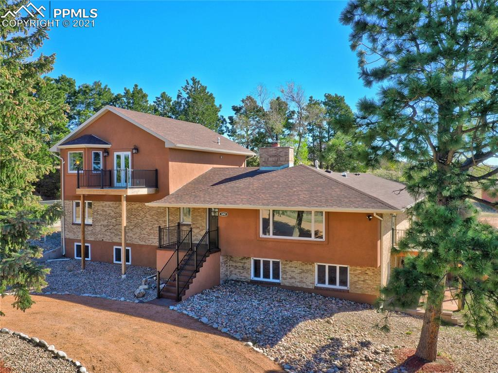 "Beautifully remodeled horse property in District 20, 5 acre lot surrounded by 13.6 acres of conservation land! Everything is new including stunning wide plank hickory hardwood floors. Floor to ceiling marble fireplace from Marble, CO.   Sweeping Pikes Peak and Front Range mountain views - Brand new upper level addition is 850 feet upper level for master suite.  Gourmet kitchen with over sized island and slab granite counters, 42"" alder soft close cabinets, built-in wine cabinet & dry bar - Under cabinet lighting & pantry."