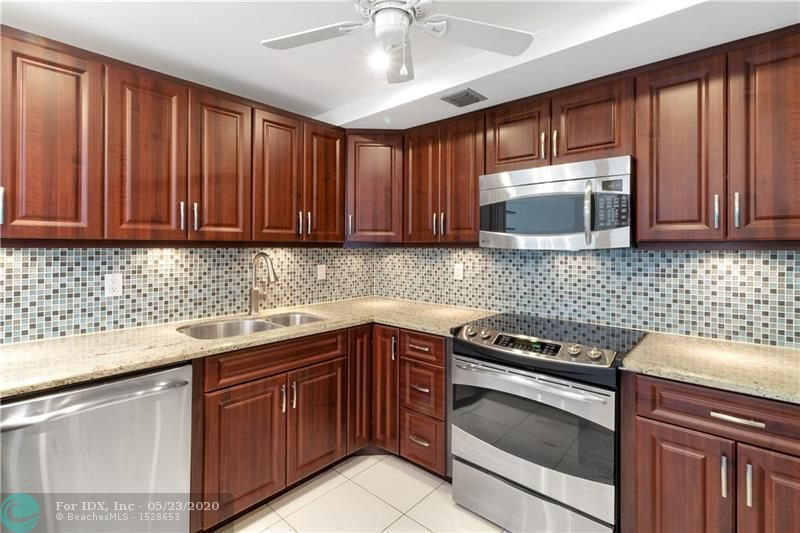 """BEAUTIFULLY REMODELED 2 bed-2 bath condo in ALL AGES 24 HRS GUARD GATED"""" ENVIRON I AMAZING DESIGNED SPACIOUS KITCHEN, GRANITE COUNTERTOP, STAINLESS STEEL APPLIANCES AND BREAKFAST BAR. RENOVATED TWO BATHROOMS, BOTH ROOMS WITH BUILT-IN CLOSETS.TILE THROUGHOUT THE UNIT. EQUIPPED WITH """"VIVINT SECURITY SYSTEM"""". ASSIGNED COVERED PARKING. EXTRA STORAGE UNIT. All AMENITIES, SWIMMING POOLS(ONE OLYMPIC HEATED SALT WATER POOL), JACUZZI, TENNIS COURT, RACKET COURTS, SAUNA, HUGE LIBRARY, AUDITORIUM, BBQ AREAS AND MORE.  HOA INCLUDES WATER AND CABLE.  YOU WILL LOVE THIS MOVE IN READY UNIT!!"""