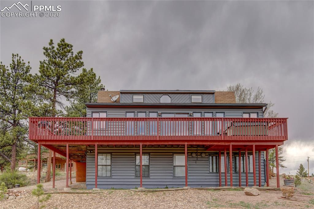 This 3 bed, 3.5 bath home would make the perfect vacation property or permanent residence. Amazing views of Pikes Peak can be enjoyed from the large deck. Separate entrance downstairs makes for a great investment opportunity. HOA dues include water, trash, use of the community building, private fishing and road maintenance in this gated community.  The subdivision backs up to Pike National Forest with several hiking trails available.