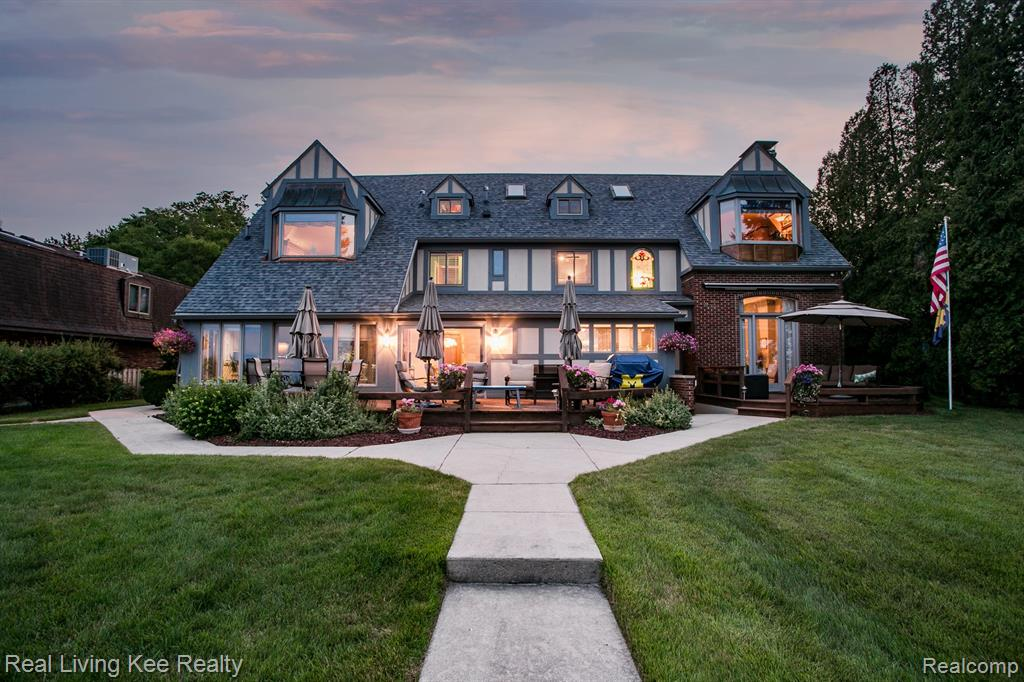 LAKEFRONT HOME, 102' on Lake Huron. Burtchville TWP.  5-6 Bedroom, 4.5 Bath, 4,500 Sq. Ft. English Tudor in Mint Condition.  Full Basement with 800 Sq. Ft of additional Living Space, Central A/C, 2 Car Attached Garage plus separate Detached Garage with Loft.  Steel Seawall and Jetty.  Boat House with Deck on Top.  Power Lift for Boat.  Breathtaking View of Lake Huron.  Beautiful Hardwood FLooring, Natural Fireplaces converted to Nat. Gas.  Extensive Remodeling in 2017:  New Roof, New Hardwood Flooring, New Kitchen (Granite), Full Exterior Painting ALL in 2017.  Formal Dining. Awesome Hot Tub in the Sunroom.  Unbelievable Living Room with Fireplace overlooking Lake.  Beautiful Master Suite overlooking the Lake plus has a  Balcony.  All Appliances included:  Wolf Gas Cooktop, Kitchen Aid Dishwasher, Sub Zero Refrigerator, Oven, Washer and Dryer.  First FLoor Laundry.  Third Floor has it own Private Living Room and Bedroom with Bath.  Tree House, Additional Adjacent Acreage is Available.