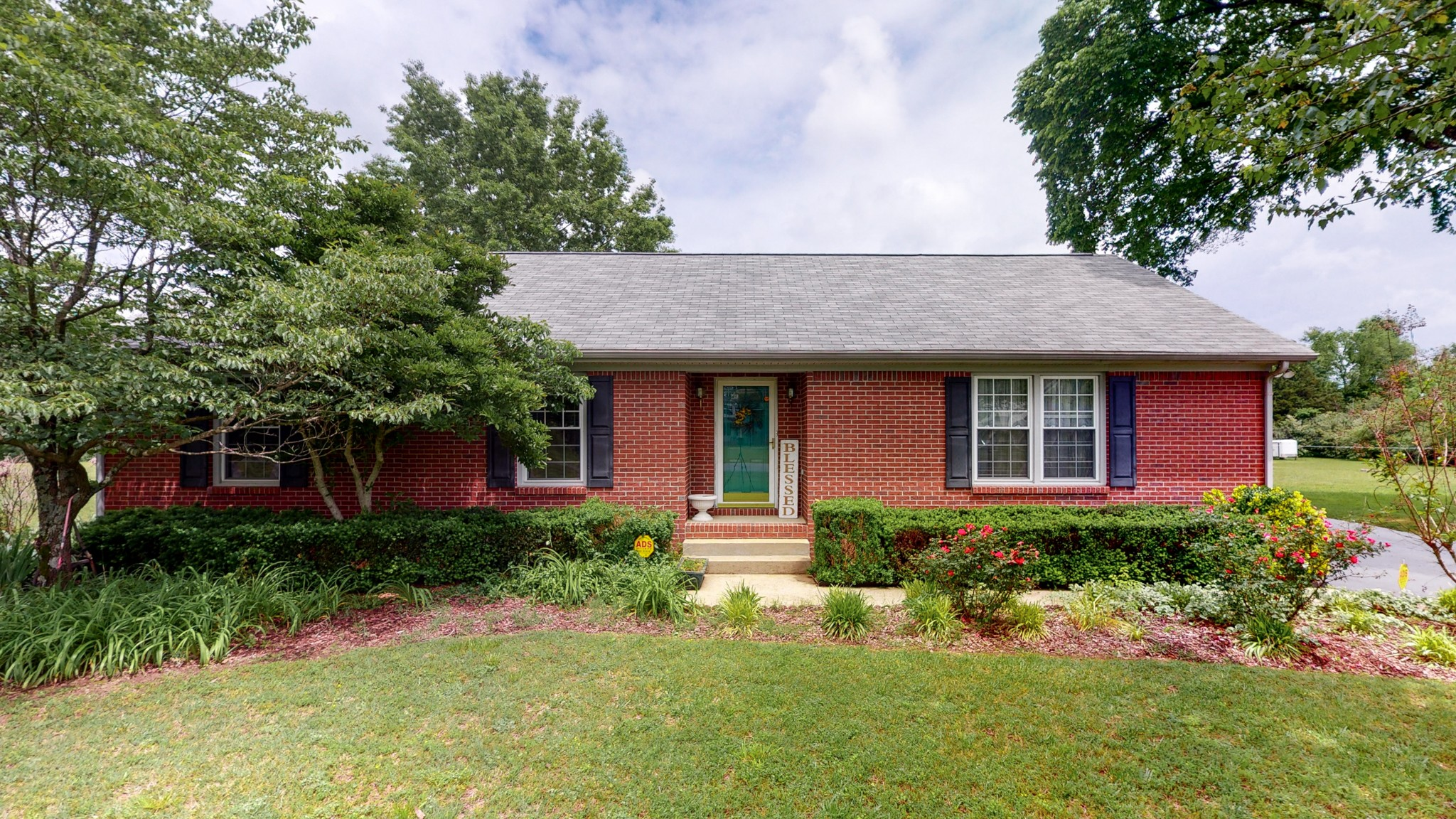 """One level all brick home on a beautiful level lot w/mature trees*Hardwood floors in the great room w/trey ceiling and gas fireplace*Kitchen w/island, pantry, and newer dishwasher*Master Bedroom includes a private bath and walk-in closet*Attached 2 car carport/patio area*Oversized 2 car garage w/electricity, workshop, and gas wall heater*Lean to shed on the side of the garage*Detached building with many potential uses for hobbies, office, """"she-shed"""" or """"man cave' plus extra storage area*"""