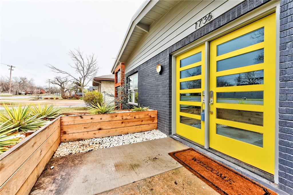 Mid Century in Nichols Hills. Terrific view of the Oklahoma City Golf and Country Club golf course from your covered patio.  Private feel home with screens blocking NW 63.  The fun and sophistication begin behind the double yellow doors.  Inside is pure mid-century with dramatic dark rich paneling. Vibrant colors. Remodeled to perfection is the kitchen and bathrooms.  Open, light and stunning is the interior finish but a touch of the 1950's with stone and deep toned paneling.  Whimsy in the kitchen remodel with a yellow range and hood.  The elegant master brings a spa retreat feel. An original spit in the fireplace calls for a BBQ the old fashion way.  Single attached garage on the front and a 2 car carport on the back gives that hard to find 3 car.  Impressive and unique and absolutely wonderful.
