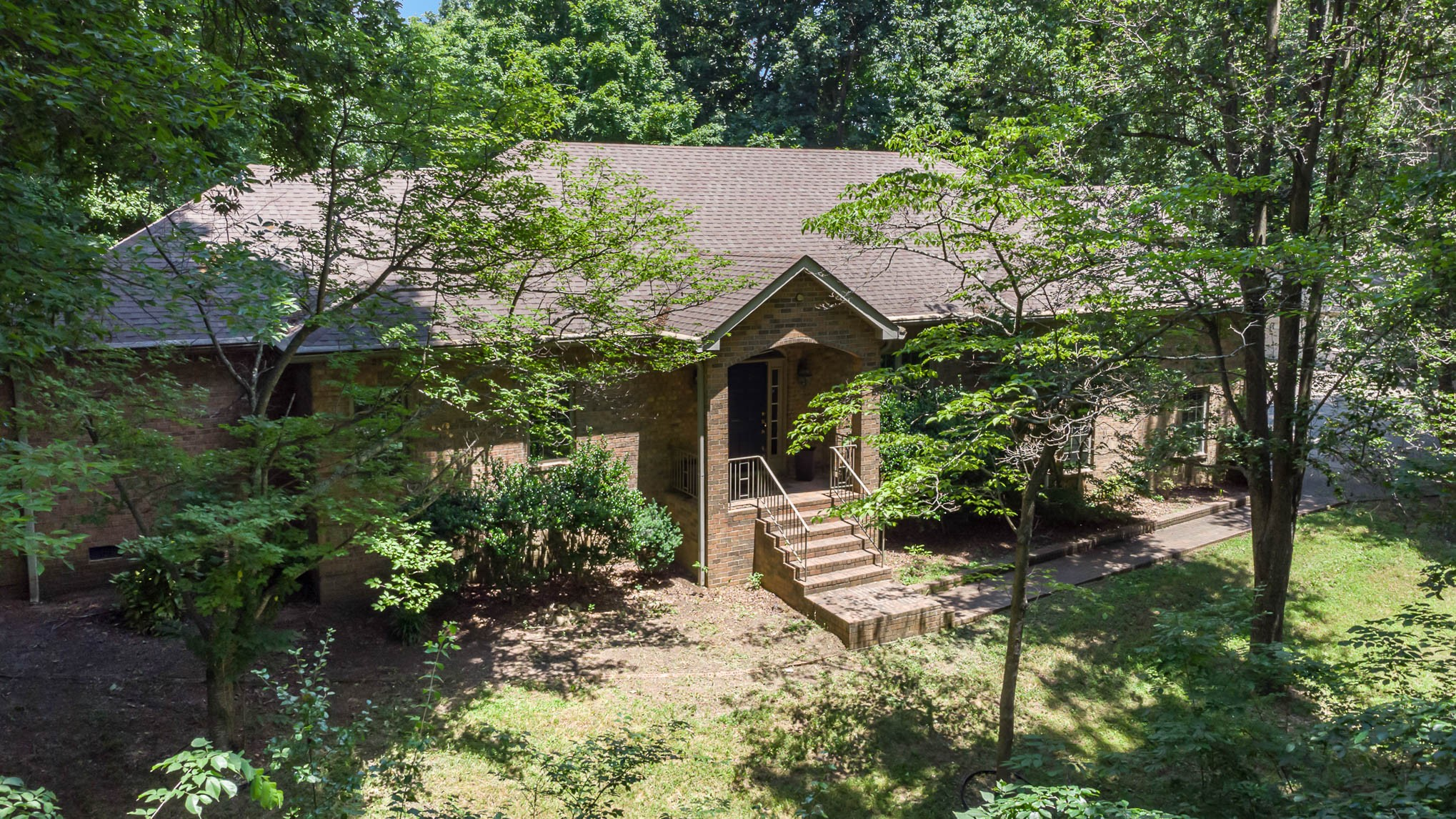 Spacious home on wooded lot with 6+ acres! Just minutes from Downtown Franklin! Lovely back deck off living room and kitchen with abundant wildlife. All bedrooms on main level with a large bonus room upstairs with half bath. Paved driveway to the house and a large workshop/storage with power.