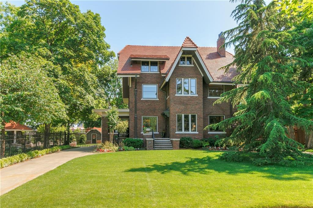 This English Manor Estate is a crown jewel of the desirable Heritage Hills neighborhood. The dominant features include a mock tower, original walnut paneling in the dining room rumored to have been cut from a single tree, historic copper double front door, and a cozy side porch. Modern upgrades inside and out make this home comfortable, current, yet classically historical. Marvel at this one of a kind kitchen renovation with a complex but functional chef's kitchen is a must-see. Beautiful Miele range, steam oven and espresso machine. Updated bathrooms complete with a 5-star master suite retreat. The third-floor renovation can be your own personal vacation or entertainment hub for family and friends. A private backyard that exudes romance and splendor with its decorative timbering, manicured grounds, spacious patio, pool & gazebo. Past the outdoor entertainment area, you'll find a newly constructed garage and guest house with a living area, bedroom, bathroom, and a kitchenette.