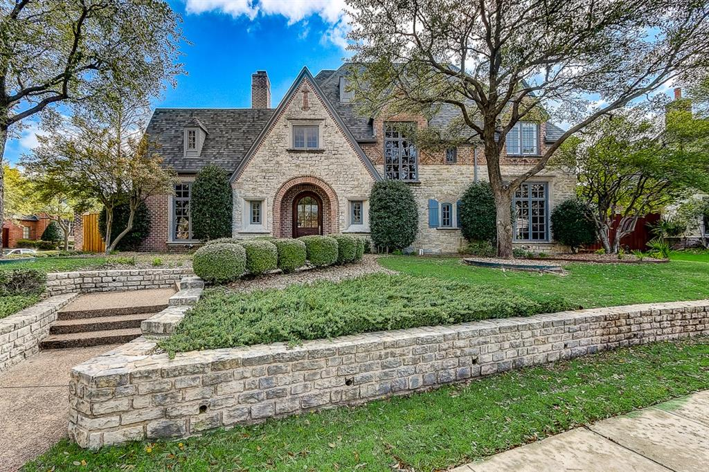 Welcome to 5644 Northbrook Drive in Plano!  Goregous stone and brick exterior glows in the twilight, highlighting the warmth and charm exuded by this timeless home.