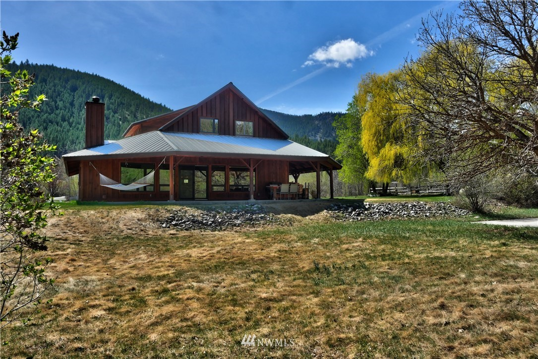 Delightful & desirable riverfront home w 272 feet on the scenic Twisp River. 3.4+ acres w sweeping river views & mature landscaping of lg weeping willow, aspen & lilacs. Relax and watch the river & bird life roll by from the covered porch & lg well placed windows. Master suite, 2 bdrms, 3 bathrooms, project/office space. Well designed open floor plan w custom features & tons of storage for recreation gear & projects. Classic & spacious barn, 2 car garage w workspace, pasture, irrigation rights.  Convenient & sunny location only a few minutes to Twisp amenities & Twisp River recreation. Strong internet connection. Property has full winter sun on December 21st!! Idyllic & practical Methow Valley home!