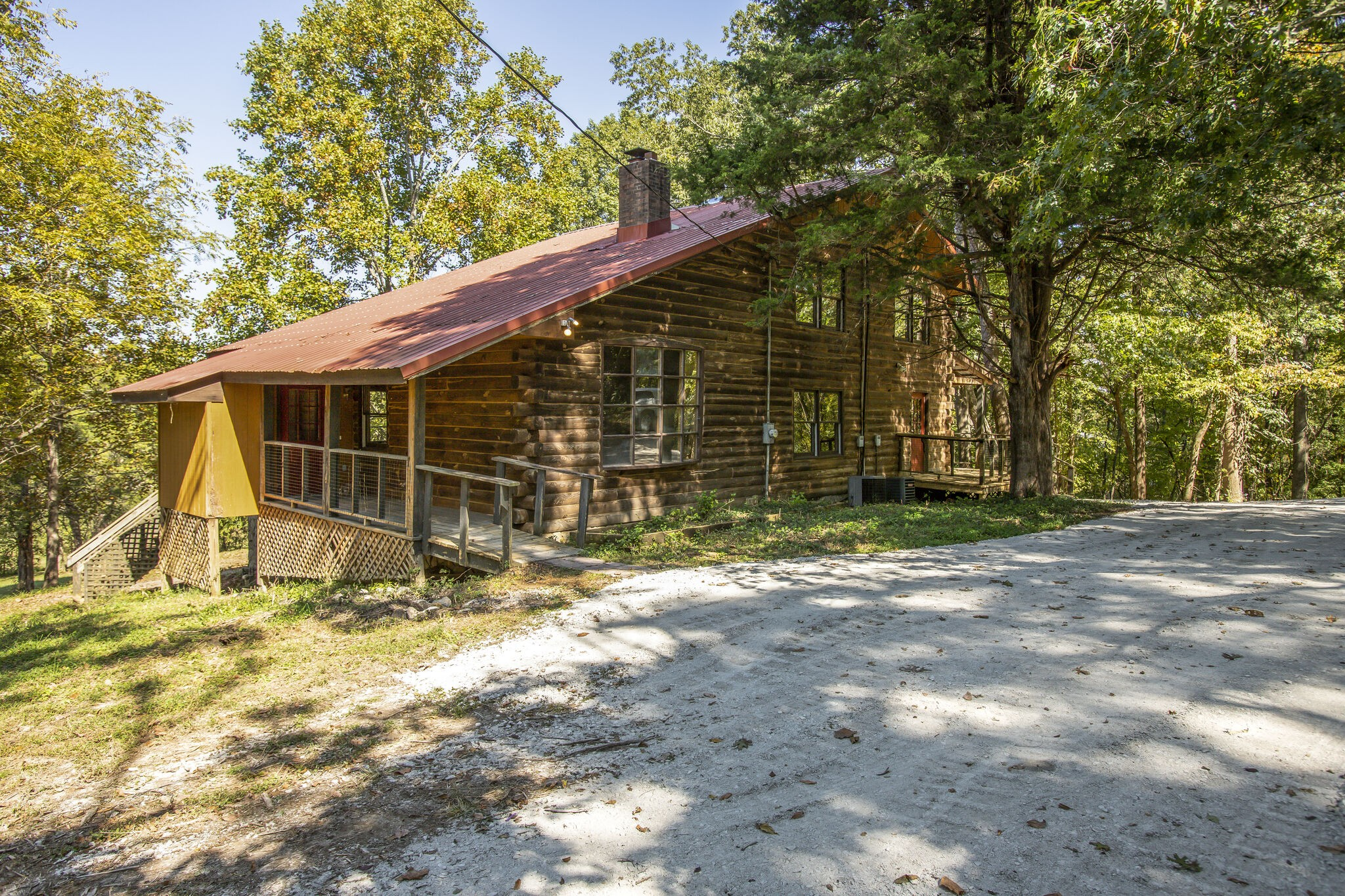 Brentwood Schools for this Log Home on 2 ACRE, treed, peaceful lot.House is teardown or major reno.Private & serene, only minutes to Cool Springs, downtown Nashville, BNA. Surrounded by million dollar homes and ready for your updates. No HOA. Breathtaking views from wraparound deck. App. 1,500 Sq. Ft. in  partially finished walkout basement. Gatlinburg in Brentwood! ADDITIONAL 5 ACRES AVAILABLE . MLS# 2190760