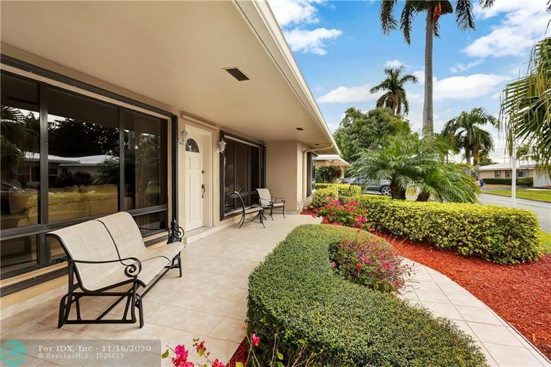 Located In Lauderdale-By-The-Sea This Beautiful Two Bedroom Two And A Half Bathroom Villa Is On A Canal With Its Own Dock That Will Take Up To A 40ft Boat. New Awning Over Back Porch. Terrazzo Flooring. Marble Counter Tops. Two Car Garage. Open Floor Plan.New A/C Unit. Maintenance Includes Grounds Sprinklers Pressure Cleaning, Roof, And Painting Exterior Of Villa. A Gated Community Consisting Of 99 Villas PYBC Has Its Own Mariner. Pool And Clubhouse Located Ocean Side. Golf Carts Welcome. Walking Distance To Shopping And Lovely Sidewalk Cafes' And Restaurants. Call Today For A Showing.    Seller Will Consider All Offers