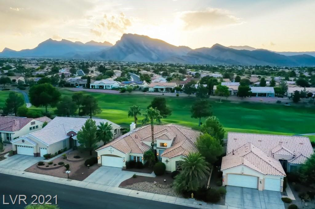 This pristine luxury home in the highly desirable Sun City Summerlin community features a grand entrance highlighting the views of the sparkling private pool, Highland Falls Golf Course and Spring Mountains that is nowhere replicated in Las Vegas. This gorgeous 3,000'+ single story features 3 bedrooms, 3 baths, a den, laundry room, large kitchen, living room and a great room with a lovely gas fireplace.This home's interior is characterized by high ceilings, marble tile flooring throughout the main living areas, and multiple Schonbeck chandeliers. The large master suite includes an elegant bath with a walk in shower, double vanities, and a walk-in closet. Sun City is within easy access to the Vegas strip and is a picturesque community with access to 3 golf courses, 4 clubhouses, multiple pools/spas, sport courts, parks, theatre, and 84 clubs. View this Las Vegas Luxury home today!