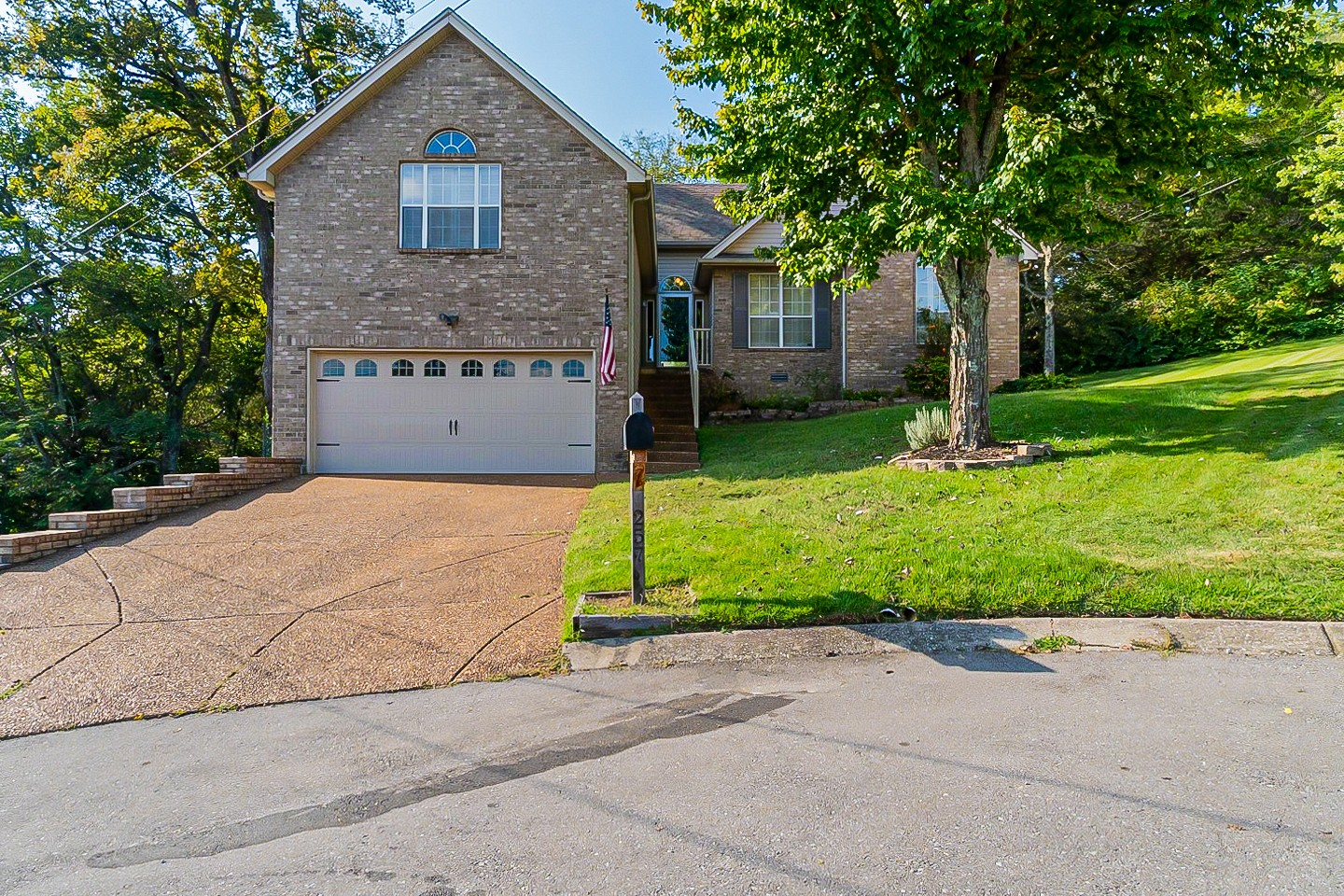 This is such an elegant, beautiful home, nestled in the Bradford Hills community in the rolling neighborhoods of Nolensville. The sprawling back deck overlooks tree covered hills and peaceful woods, and even has a workshop! Featuring large windows, an updated kitchen new carpet throughout, and fresh paint, this home is move in ready!
