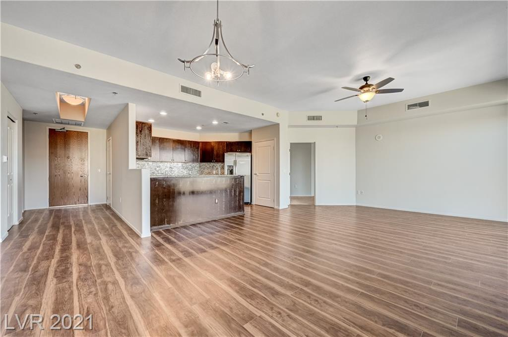 Are you looking to right-size? This spacious 3 bedroom 3.5 bath condo is calling your name! Sizeable primary private suite with private entrance features en suite bath with walk-in shower and deep soaking tub. Create the custom closet of your dreams in your primary suite. Take in amazing Sunrise and Pool views from TWO oversized balconies. Your open kitchen features granite countertops with breakfast bar, stainless steel GE appliances with a huge pantry. New laminate flooring. Two roomy bedrooms on opposite side of residence, perfect for a guest bedroom and home office. 8x13 temperature controlled storage unit and 2 parking spaces included. Prime location on South Strip; mins from Allegiant Stadium, McCarran & I-15. Walk to Smith's, CVS, Starbucks & more. Resort living: 24 hr. amenities, 2 story fitness center, resort pool, business center w/conference room, controlled access, 2 dog parks & more. Fannie Mae & VA approved community.
