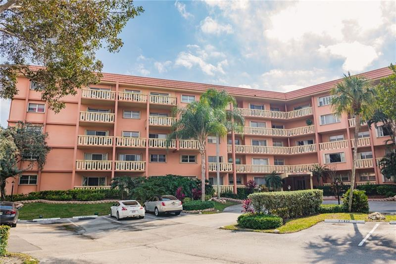 Good Value! Spacious 1 Bedroom/1 Bath Condo on the 4th Floor Overlooking the Treetops*Large Private Balcony*Stackable Washer&Dryer in the Apt. Utility Room*Walk-thru Closet from Bedroom to Bathroom*Two Pets Under  20lbs. Welcome*HOA Fee includes Basic Internet, Basic Cable, Reserves, Insurance, Water, Sewer,Trash, Pest Control & More*24/7 Guard at Gated Entry to the Island*24/7 Security Patrolled*Fully Equipped Gym, 3 Heated Pools, 2 Tennis Courts, BBQ Grills*Efficient Management Office On-Site*Ready for You to Remodel to Suit Your Taste! Building Approved for 95% Mortgages*No Fixed Bridge Dockage Up to 50' When Available Can Be Rented at a Reasonable Rate from the Assoc. River Reach - The Only Condominium Located in the Exclusive Tarpon River Neighborhood!