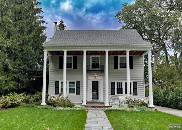 WELCOME TO THIS CENTER HALL COLONIAL WITH RELAXING COVERED FRONT PORCH.  THIS HOME IS CONVENIENTLY  LOCATED IN THE SOUGHT-AFTER WILLARD SCHOOL DISTRICT CLOSE TO TOWN, TRAIN, NYC BUS AND SCHOOLS. THE  FIRST FLOOR HAS A BEAUTIFUL LIVING ROOM WITH FIREPLACE AND BUILT-INS, FORMAL DINING ROOM, MODERN EAT-IN-KITCHEN WITH VIKING STOVE, POWDER ROOM AND BRIGHT FAMILY ROOM WITH FRENCH DOORS THAT LEAD TO THE PATIO AND POOL. THE SECOND FLOOR HAS A PRIMARY BEDROOM WITH  BATH AND HIS AND HER CLOSETS.  THERE ARE THREE ADDITIONAL BEDROOMS AND A NEWER HALL FULL BATH THAT COMPLETES THE SECOND FLOOR. THE THIRD FLOOR BEDROOM (OR OFFICE) HAS A WALK-IN-CLOSET AND PLENTY OF STORAGE. THE BASEMENT IS FINISHED WITH CERAMIC WOOD LOOK TILE, LAUNDRY ROOM, GAME ROOM WITH BUILT-IN BAR W/ SINK & BEVERAGE REFRIGERATOR, HALF BATH AND  PLENTY OF STORAGE.