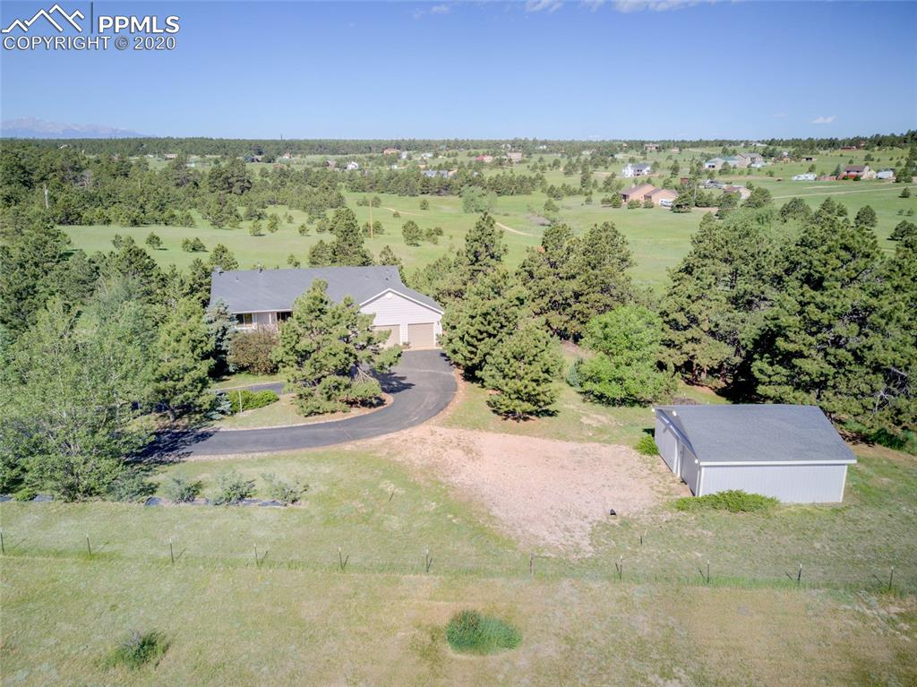 3,105 sq ft walk out Ranch on 5 fully fenced gorgeous acres, -trees, meadow & views!  24'X24' detached 2-car garage/barn equipped with electricity. Gourmet kitchen features granite w/granite tiled back splash, appliance garage, cork wood floor, countertop bar seating, upgraded vent hood, S/S appliances, gas stove top & message center.  Newer LG refrigerator included!