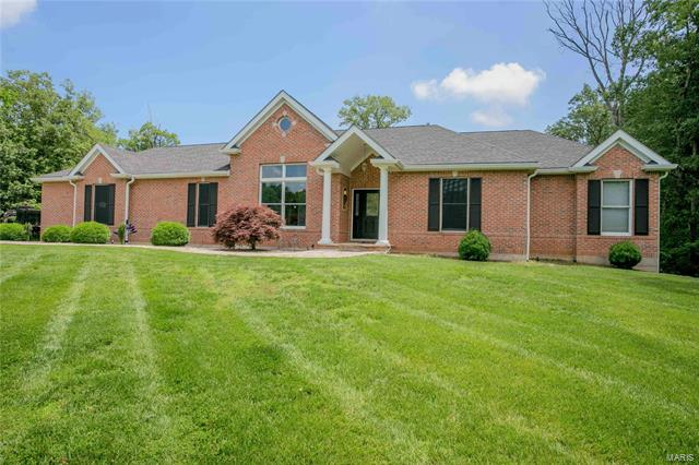 Full brick custom built ranch on 3 acres in Josephville located on a quiet private street. Over 2400 sq ft on main level living space and a 60X14 deck with a concrete floor overlooking private wooded 3 acres. There are two 31X26 garages! One side entry on the main level and another 31X26 workshop under the upstairs garage in the lower level. 9 ft ceilings on the main level with hardwood flooring in the great room, tile flooring in the kitchen/breakfast room with natural hickory cabinets. A large master suite has luxury bath with heated floors. 10 ft basement pour is partially finished with a family room, bedroom and bath. The LL walks out to a 60X14 ft patio and level yard backing to trees. Newer roof, brick on all sides and many more custom features! This home is in need to some updates and maintenance and is priced accordingly. Paint, carpet, appliances, hardwood refinishing and some rotten wood on doors needs addressed.