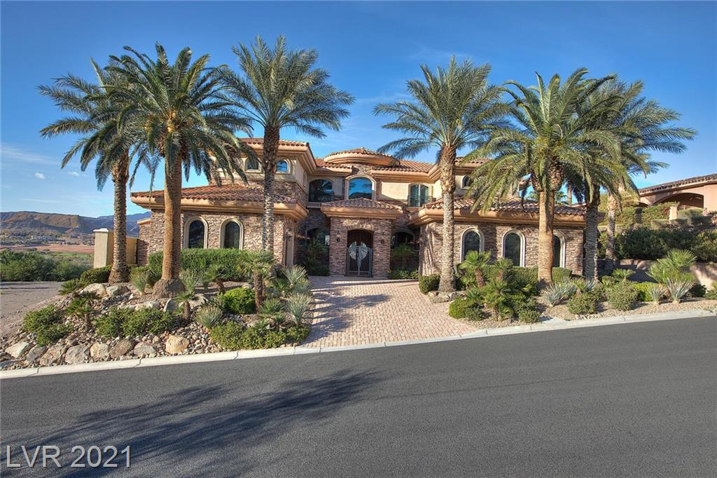 The most beautiful lake views in the all of Lake Las Vegas! Sensational lake, mountain and golf views. Wrought-iron gate leads to courtyard with arched double doors. Exquisite detail in the floors/ceilings, venetian plaster, custom etched glass, full bar, 3 spacious master bdrm w/ customized walk in closet & bath suites. The chef's kitchen features stainless steel appliances, dual dishwashers, dual Miele Gas Ovens, center island with bar seating. Enjoy the enormous theater, chilled wine storage, library & infinity edge pool. Purchase includes Lake Las Vegas Sports Club Membership valued at $10,000.00
