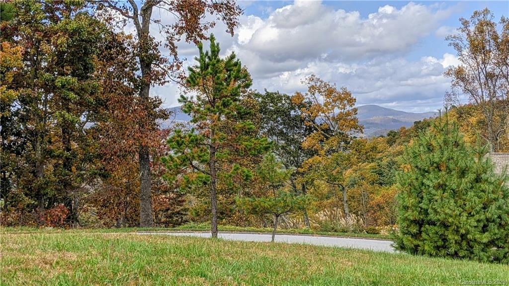 Feel the gentle, cool mountain breeze. Watch the butterflies dance through the air. Gaze at the mountains in the distance. Ponder on your next day of fun or just sit back and relax. This could be your daily routine from your new home on this ready-to-build lot in Hendersonville, North Carolina at the Eagle's View subdivision.  Bring your builder to this gently rolling and cleared 1.23 acre lot to plan your dream or vacation home in the Western North Carolina mountains. The combined lot offers many opportunities to position your new home to maximize the potential for long range mountain views. This no-HOA community with spacious lots also has underground utilities.