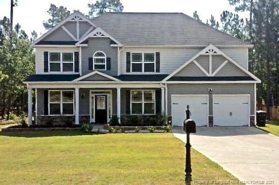Wonderfully maintained Two- Story home in the established subdivision of Carolina Lakes. This home features wood foyer, formal dining, family room/office, great room with masonry fireplace, tiled eat in kitchen with granite counters, island, and updated stainless appliance. Guest bedroom downstairs with attached bath. Over sized Master suite with additional sitting area, vaulted ceilings, huge walk in closet, garden tub, separate shower and double vanity. Upstairs  tiled laundry room with shelf and open loft with natural lighting above stairs. Covered front porch, double car garage, patio and large rear fenced backyard great for entertaining. Did I mention the great amenities? Community pool, fishing, boating, and walking trails!  Schedule your showings today!