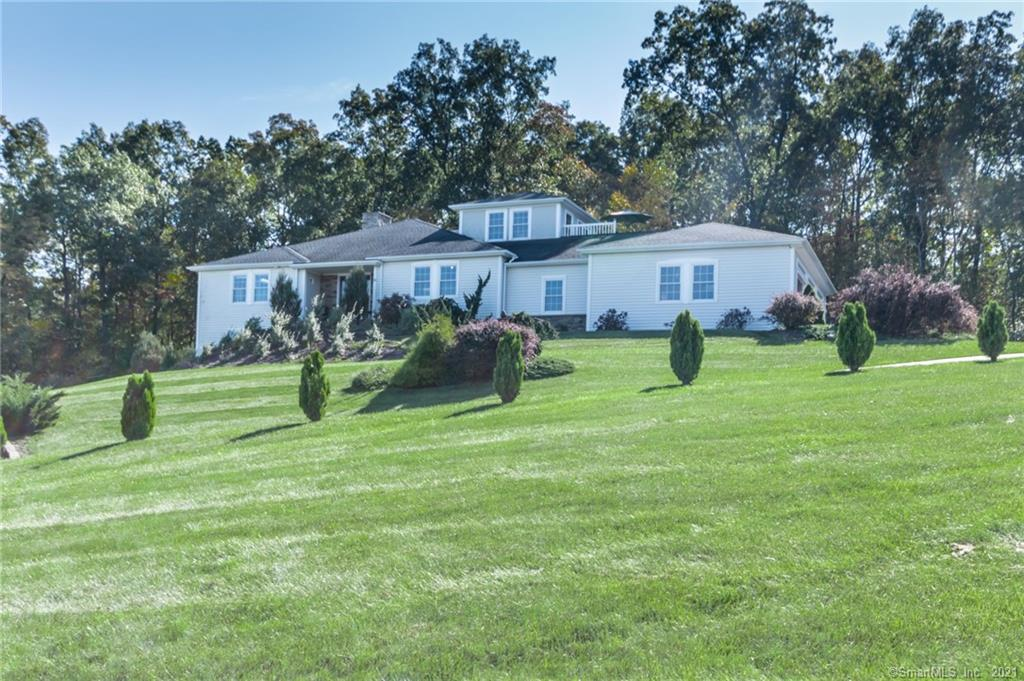 Located on one of Manchester's most desirable cul-de-sacs and surrounded by 177 acres of conservation land, this custom built 2011 contemporary ranch style home showcases breathtaking views through out the whole property. This residence offers 4 bedrooms, 2 full baths & 2 half baths and an open floor plan with the eat in kitchen with island opening into the spacious living room with vaulted ceiling and floor to ceiling stone fireplace. The expansive master suite with balcony offers top of the line bathroom with dual vanity sinks and tiled showerwith built in shelving.Other features include three car garage, large fenced in yard with, whole house air filter central air conditioning, and high end construction through out.Be prepared to be wowed with every step you take through this home which offers it all and much more!Schedule your private viewing today and come see everything that 40 Desousa Dr has to offer! Located on one of Manchester's most desirable cul-de-sacs and surrounded by 177 acres of conservation land, this custom built 2011 contemporary ranch style home showcases breathtaking views through out the whole property. This residence offers 4 bedrooms, 2 full baths & 2 half baths and an open floor plan with the eat in kitchen with island opening into the spacious living room with vaulted ceiling and floor to ceiling stone fireplace. The expansive master suite with balcony offers top of the line bathroom with dual vanity sinks and tiled showerwith built in shelving.Other features include three car garage, large fenced in yard with, whole house air filter central air conditioning, and high end construction through out.Be prepared to be wowed with every step you take through this home which offers it all and much more!Schedule your private viewing today and come see everything that 40 Desousa Dr has to offer!