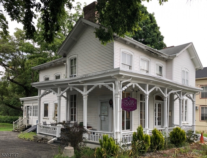 Classic Victorian building for commercial use located on large 1.9 acre lot. Detached 4 car garage also on property. Perfect location for Professional Services - CPA, Engineer, Attorney and much more!