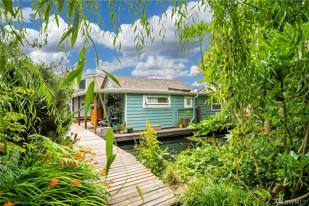 Packed with a punch, this colorful and delightful studio floating home is full of fun. Since 2006, owners have put on a new roof, gutters, deck, skylights, stringers, and exterior paint. In 2017, they did a studs out remodel which includes blown insulation, wiring, plumbing, new kitchen and bath, tankless water on demand. One deeded parking spot. Beautiful gardens on the shore welcome you home.  Great condo owned dock. Gas is available on the dock.