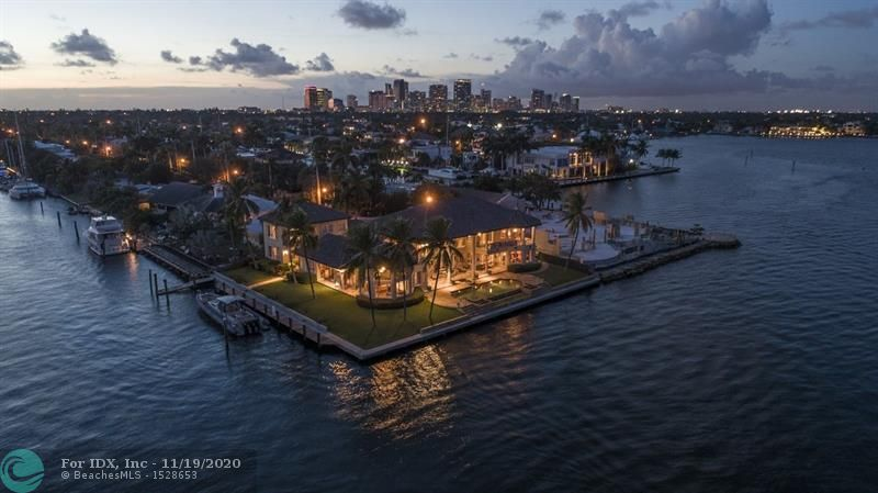Spectacular Intracoastal point lot estate with panoramic wide water views from 17th St. Causeway to Harbor Beach to the Las Olas Isles. 130 ft. of direct Intracoastal waterfront in a No Wake Zone plus 130 ft. on a protected wide & deep draft canal, all less than a mile from open ocean access. Southeastern breezes and an east facing pool will provide countless days of sunny mornings and cooler afternoons. This custom built, 6B/6.5BA home sits on a high elevation and has many unique architectural details. Boasting over 9,810 total sq. ft. of luxury living, this home has a 2B/2BA guest house and 3 oversized garages plus a workshop. Other luxury features include an elevator, waterfront pool, wrap around terraces, large eat-in kitchen and stunning water views from almost every room in the home.
