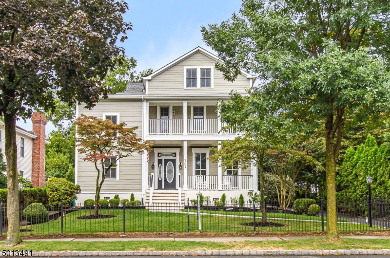This Magnificent 6BR/3.1 bath home has it all! Steps to downtown Cranford & NYC train/bus. Chefs Kit. overlooks large manicured backyard w/ paver patio.  Features custom cabinetry, Viking appliances, breakfast island, wet bar, sep. Dining Area and W-I pantry. Formal Dining Rm, Office/ Library w/ 2 workstations, Guest BR w/ full bath (w/ room for expansion), Great Room, FR & LR (w/ gas fireplaces). 1st fl. also has hardwood floors, 10+ft. ceilings w/ ornate woodwork, reflective of the grandeur of its era. Large MBR suite/ bath on 2nd fl. w/ jetted tub/ stall shower/ dressing rm. Adjacent BR has access to 1 of 2 covered porches. 2nd fl. laundry off bonus rm. 3 additional BRs w/ another Full Bath on 3rd fl.  Dry, partially finished basement w/ 5th bath as-is. 3-car garage. NO FLOOD ZONE! NEW HardiePlank facade.