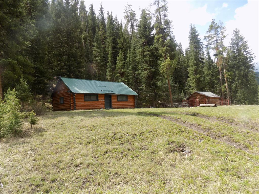 Here is your chance to have a piece of Heaven on the outskirts of the Gallatin Canyon and Big Sky.Enjoy spring/summer months hiking,fishing, horse back riding,rock climbing or hunting,snowmobiling and skiing in the fall/winter. Quaint, rustic and cozy cabin surrounded by trees, fabulous views and a creek runs through it! Enjoy a camp fire under the stars & If you don't feel like cooking enjoy a meal/cocktail at the 320 or Rainbow Ranch. This area is very quiet with only 4 other cabins and loads of wild life such as Deer,Moose,Elk, Birds etc..Buffalo Horn Trail Head is a short walk away.The cabin does not have running water or a bathroom(out house)but improvements can be made with FS approval.This cabin would make a great get away for anyone.Plenty of cabinet space,wood stove,sink,refrigerator,and two sets of log beds.Enjoy extra storage with the old barn and plenty of room for large crowds,horses,atvs and all your other toys. Cabin does have electricity.FS lease is $3701/yr. Cash Only!
