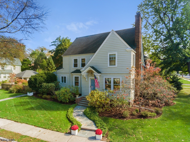 This charming 4 BDs / 2 BA Colonial has it all! Updated kitchen, baths, HW floors & backyard oasis! Large Front foyer w/ coat closet, spacious and bright living & dining rooms. Wood burning fireplace in living room. Breakfast room & eat-in area w/ access to patio. 1st Fl full bath room & guest bedroom.2nd floor offers a Master w/ large sitting room, and 3 more spacious bedrooms & fully renovated hall bath. Huge 3rd floor attic with ample storage and lots of potential! Full basement has high ceilings, storage/ workshop space! 2-car detached garage & large level backyard w/ private patio! Don't miss this great opportunity!