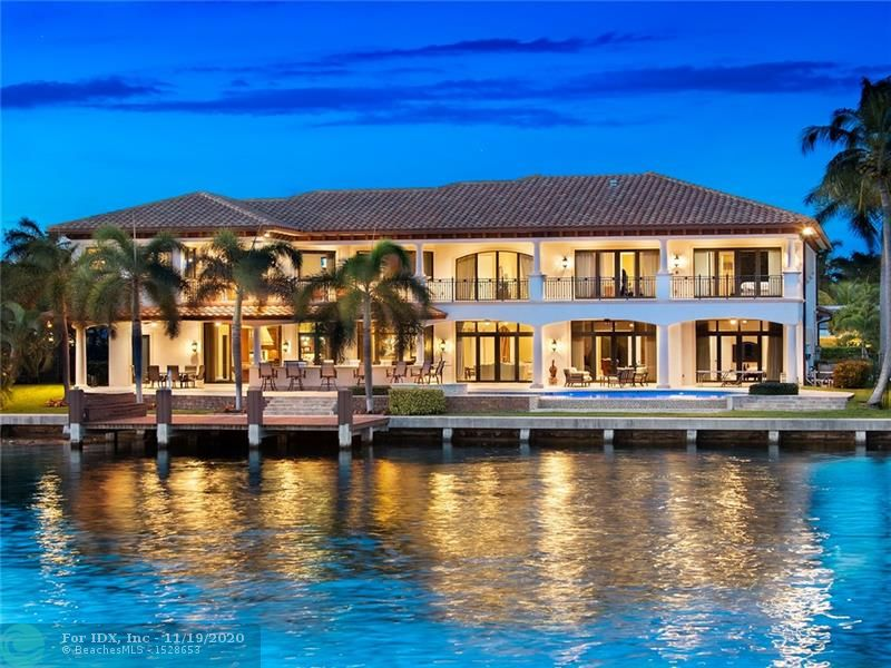 One of a kind waterfront custom estate in Coral Ridge Country Club.  Dock your mega yacht. 150 ft of dockage with 200 ft of wide water views.  Amazing water views from all the rooms.  Enjoy wine tasting in your own custom wine cellar which holds 857 bottles.   Great for entertaining with surround sound and  open floor plan.  Over 20 ft ceilings, elevator, office, fitness center, gourmet kitchen with island & more.  Relax in you stunning backyard with wonderful summer kitchen, pool and covered patio. The best outdoor living in South Florida.  Best of both worlds walk to golf or hop on your mega yacht in minutes.  Location! Location! Location! Golf, tennis, beach, restaurants all in walking distance.  The best of the best.  A must see.