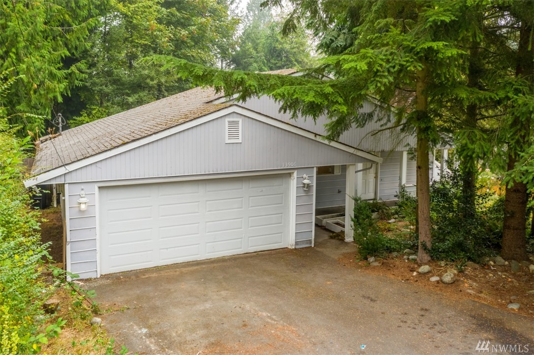 Remodel a Mid-Century daylight rambler and live within minutes of eateries and retail in downtown Redmond. Move in and remodel, or complete the project up front. Either way represents opportunity for equity. The design lends itself well to a large open main floor. Overlooking a big private yard is a large deck. A huge rec-room opens to the patio. These spaces and the yard make this a great home to rest, recreate, and entertain. Make it uniquely yours and love where you live. 10 min to Microsoft.