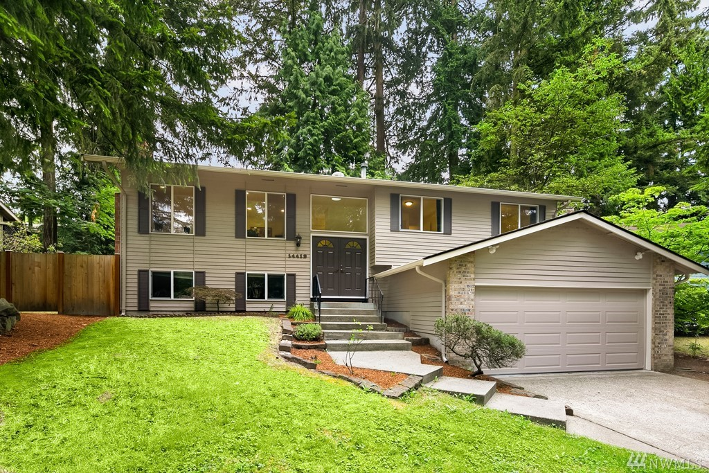 Beautifully updated Kirkland home in a quiet & private cul-de-sac location. Kitchen offers stainless steel appliances with gas cooktop range & maple cabinets. Newer 6 yr old 50 yr roof, newer doors & windows and freshly painted.Light & bright living space w/designer gas fireplace, dining room leads to oversized 12X18 deck.  Lower level Includes an enormous bonus room with a  gas fireplace & additional large bedroom or home office next to a 3/4 bath. Award Winning Lake Washington School District!