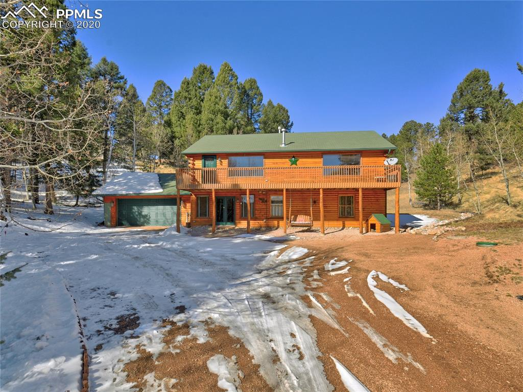Gorgeous log home in a scenic mountain setting among the aspen and conifers with unobstructed Pikes Peak views! Wow, that checks off all the boxes! Spacious, open and bright, the interior is efficiently laid out with the large master suite on the main level. The great room walks out to both the front and back wood decks; one with warm, sunny southern exposure for the winter and the other with cool shady northern exposure for relaxing in the summer. Lots of outdoor play space on over an acre of beauty. Community lakes.