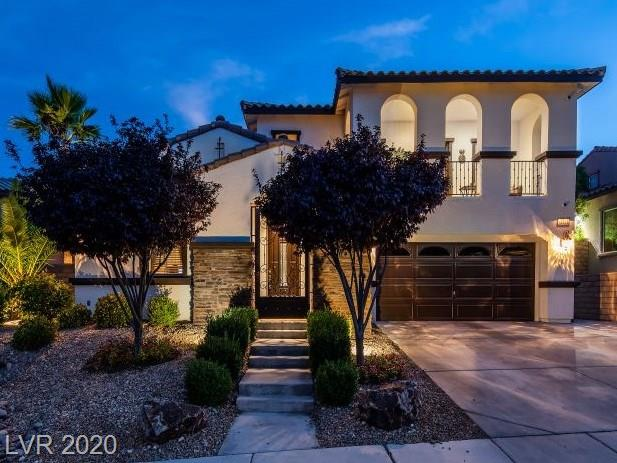 This lovely Summerlin dreamhome is located in a premier gated Paseos community. From the bedroom balcony, enjoy captivating mountain views of Red Rock while relaxing fireside in your private infared sauna. This home has been meticulously cared for by the original owners. Its recent improvements include: exterior freshly painted, tankless water heater, HVAC replaced in 2019 with 16-Seer Trane units, kitchen appliances upgraded in 2018 to a gourmet stainless steel line (built-in refrigerator, warming drawer, oven, dishwasher and ice maker). The backyard oasis features a 45' pool with sports net, spa, fountain features and wet deck. All exterior hard surfaces redone in 2020. Three spacious bedrooms upstairs, upstairs loft, downstairs bedroom with ensuite full bath. Seller is conveying home with ALL mounted TVs, security cameras, washer, dryer, refrigerator & sauna. Furnishings are negotiable. The garage is oversized with overhead storage. Zoned for highest ranking schools.