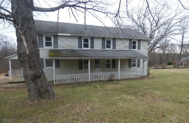 3 Acre lot with a Colonial home with 4 bedrooms and 2 full bath, separate dining room with sliding door to the wood deck. Detached 1 car garage.  Needs some updating.  Sold AS IS condition, buyer is responsible for all inspections and town certifications.
