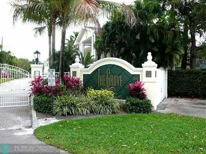 The Grove; Turnkey 2 bedroom 1 Bath Condo in the Heart of Wilton Manors. Walk to the Drive  Second floor unit with a lovely kitchen and updated Bath, tile floors with carpet in both bedrooms. This sought after gated community offers a community pool and large laundry facility. Assigned parking. Well maintained, relaxed rental policy Ok to Lease 1st year. Dog Friendly.