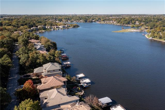 Why build? This four year new Dream House has the most panoramic lake front view available at Lake Winnebago, with deep water on highly sought after South Shore Drive! Builder's own home loaded with upgrades, including: tile roof,  private dock with lift, full stucco and real stone exterior, 3 car side entry garage and sound system! Lots of windows for maximum lake views at every turn! Very open ranch/reverse 1.5 story floor plan features: kitchen with island and walk-in pantry open to family room with clear alder beams, 4 bedrooms (including 3 bedrooms on first floor), spacious master suite with huge shower and access to oversized, covered and vaulted composite deck, finished walkout with wet bar and patio overlooking lake! Rare opportunity for newer home on one of the best lots at the lake!