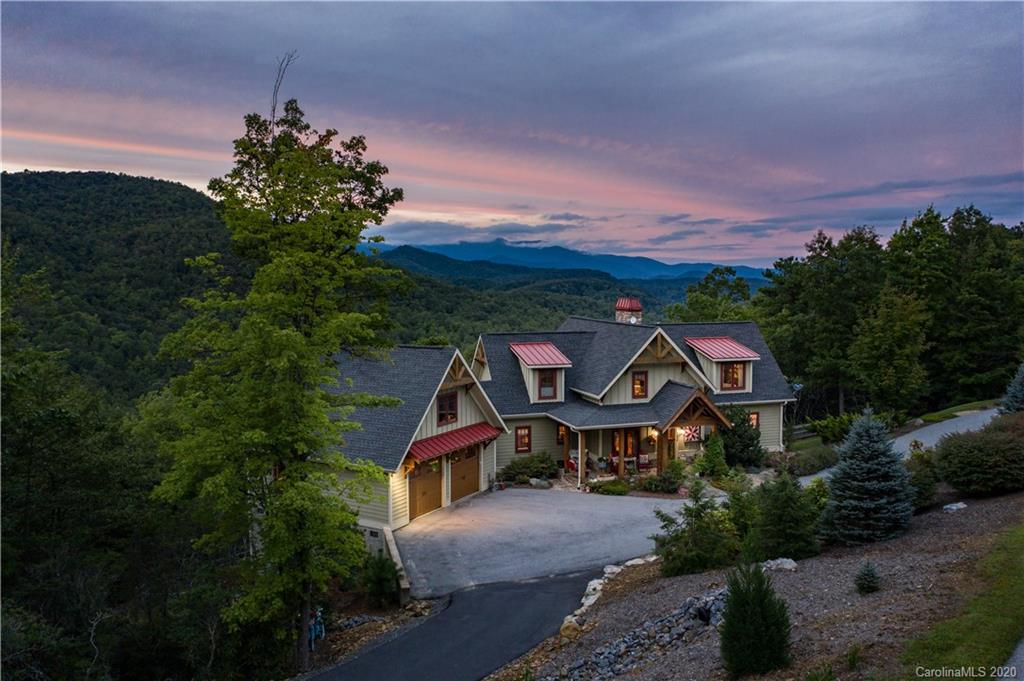 Multiple offers, Highest and Best by 5 PM on 9-30-2020. Magnificent mountain view property in the Catawba Falls Preserve. Meticulous maintenance and attention to detail shines through in every room. Enjoy relaxing by the stone fireplace in the large great-room with picture windows that showcase the long range mountain views. The kitchen with gas oven/range and stainless appliances invites you to enjoy cooking holiday meals for family and friends. Living-space extends to the outdoors with a screened in porch and additional fireplace to enjoy the fresh mountain air. There is a large finished room in the basement ideal for hobby room or recreation room, with french doors leading to your lower level screened in patio and hot tub. Adjacent Lot 213 is also available and offered at $60,000.00. Creek at the bottom of the lot has a 20 foot water fall and property boarders the Pisgah National forest. Catawba falls offers miles of trials that lead to The Catawba Falls.