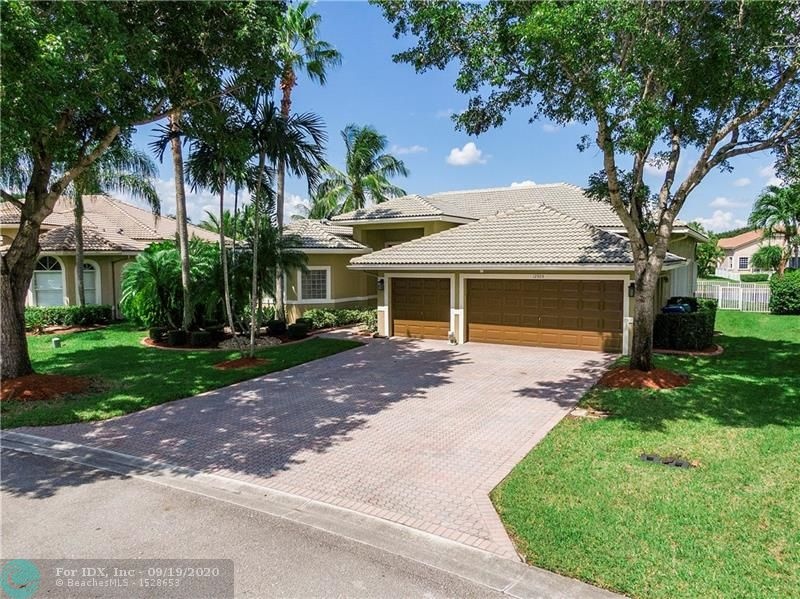 Amazing 4/3/3 Capri model home in gated Pelican Isles! This freshly painted waterfront/pool home features an open triple-split floor plan: 14 ft ceilings, crown molding, 16x16 Ceramic tiles, Granite  counter tops & backsplash, 42-inch wood cabinets, SS appliances, recessed lights, pantry, with eat-in Kitchen, formal dining room with crown molding, family room overlooks resort style pool and add'tl screened patio, 1-new AC of duel system, Accordion shutters, large laundry room, beautiful tile &   laminate flooring thru-out living areas & bedrooms,  spacious master suite boasts tray ceiling, dual walk-in closets, dual sinks/vanities, roman tub & separate shower. LOW HOA fee $135/mo  includes lawn/landscape care, sprinklers, gate & common areas. Top-Rated Schools, shopping, easy access Xpway.
