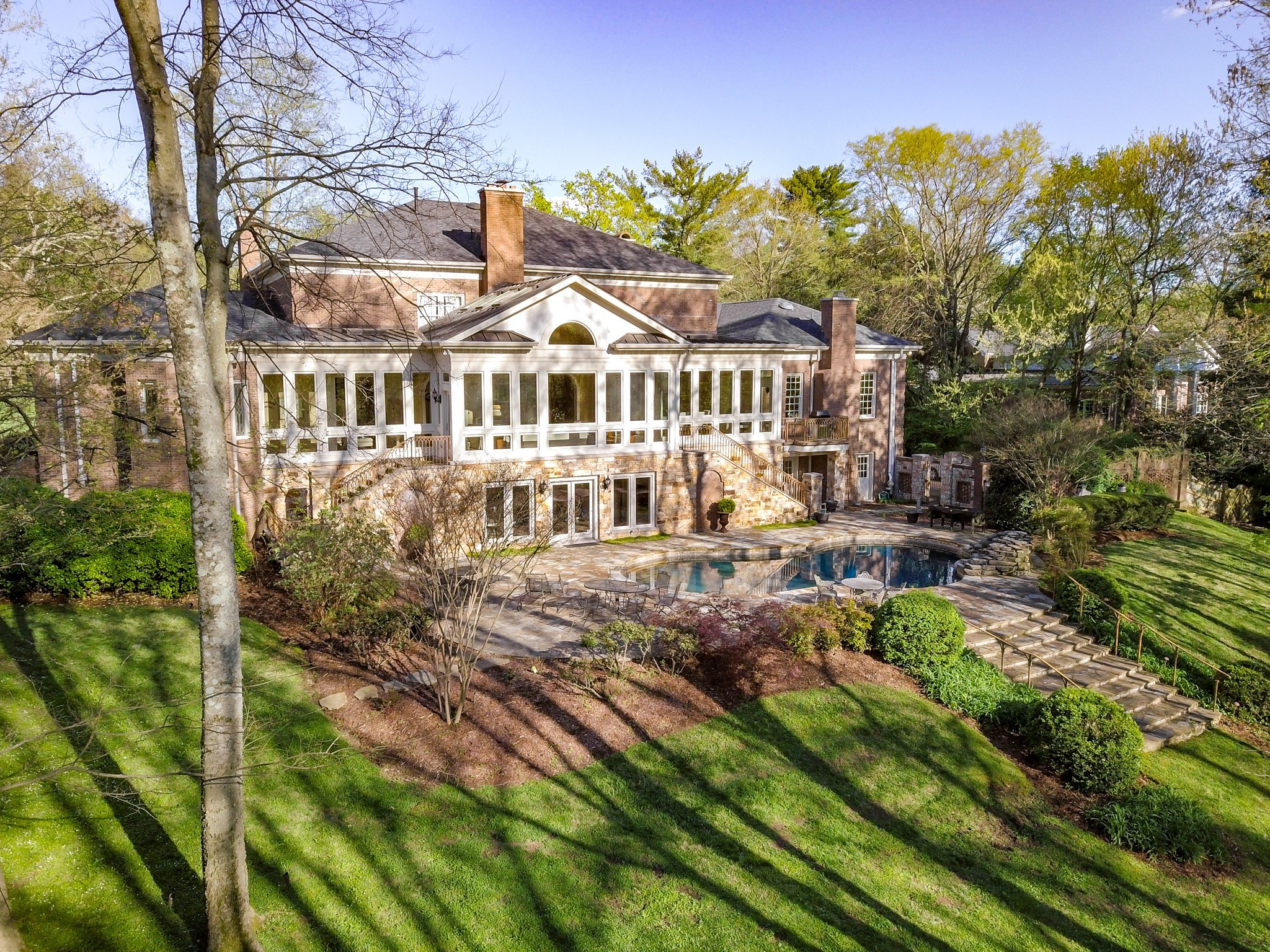 Incredible 2.6 acres in prime Belle Meade (2 parcels). Traditional brick residence, best described as Southern Colonial. One owner. Extensive expansion in 2006-2007. Walls of glass & soaring ceilings add volumes of space while flooding rooms with light. Pool and terrace. Almost 10,000 sq.ft. Easy to personalize kitchen and baths within existing spaces. Wooded with trails in back for privacy, or clear for soccer field. Genrator!