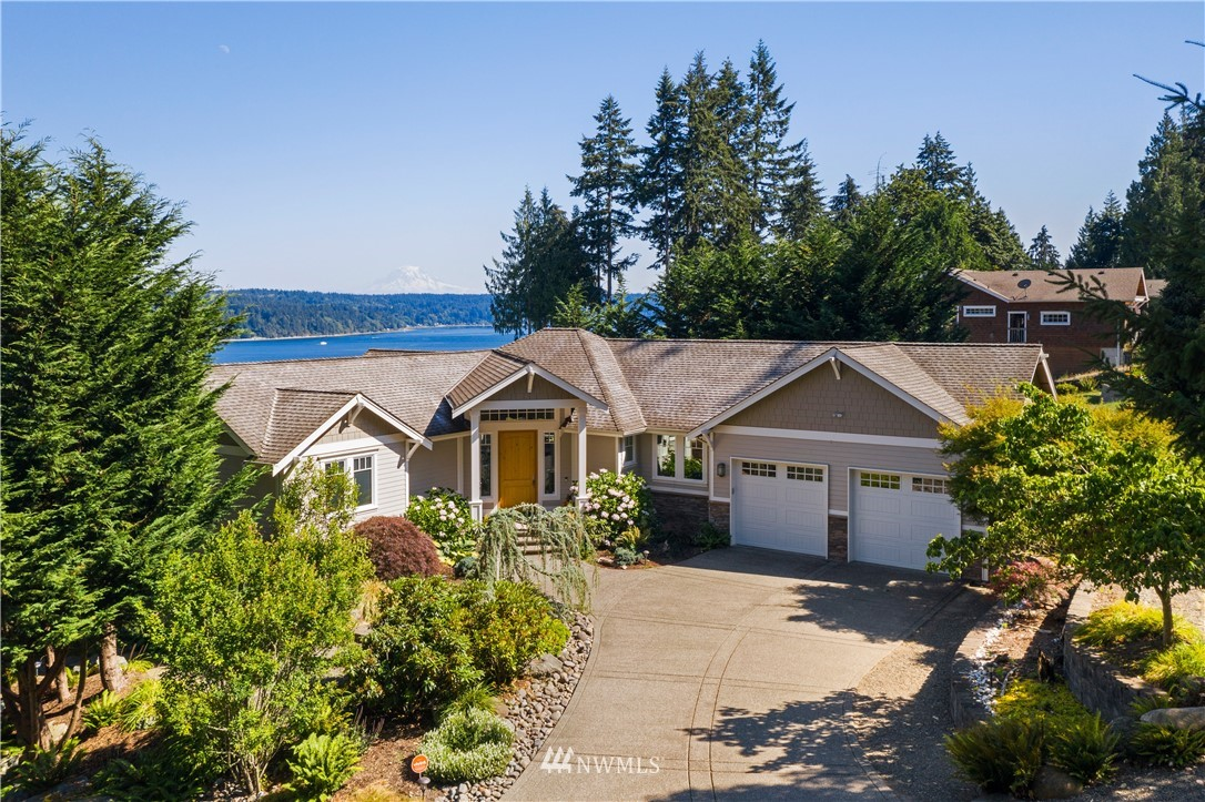 Welcome to your peaceful/private waterfront sanctuary on the shores of Colvos Passage w/ dramatic Rainier views! Custom built in 2009, the home is set up perfectly for main floor living/entertaining together w/ ample luxury space for guests PLUS addtl detached shop/garage/RV space.  Graceful, elegant & a touch of rustic - solid hardwoods, knotty alder cabinetry, fantastic kitchen w/ Viking appliances, wet bar w/ 2 wine refrigs.  Expansive deck, patio, & firepit to enjoy the incredible vistas.