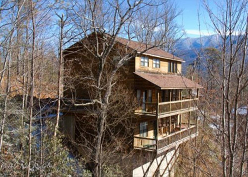This is an amazing rental property located in the Private Village of Cobbly Nob.  Just 10 miles from the center of downtown Gatlinburg and Breath taking views of the Great Smoky Mountains National Park.  This is a great investment property that will be a rental income generator for years to come.  The home is being offered fully furnished and is ready to go on rentals.  This homes current rental configuration is 2 king size bedrooms on the main floor, upstairs offers a king size bedroom and a loft area with 2 queen size beds, downstairs offers a king size bedroom and a bonus room that currently has a twin size bunk bed.  The Village of Cobbly Nob is a quiet, relaxing, and scenic area offering million dollar views of the National Park that will never change.