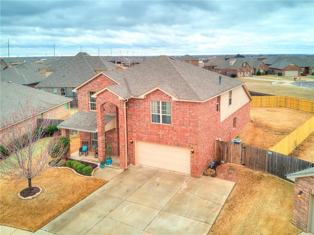 """This 4 bedroom, 3 bathroom home in the Edmond School District has too many upgrades to list. This home features hand-scraped bamboo floors. There is a custom made knotty Alder mantle above the fireplace in the living room. The kitchen has knotty Alder cabinets as an upgrade. The theater room contains a projector and a 180"""" screen as well as a dry bar. The AC is zoned for maximum comfort during those hot Oklahoma summers. The stairs hide a reinforced closet underneath. There is a newer 50-gallon hot water tank to keep things hot even on the coldest Oklahoma days. Feel a sense of privacy with the newer 6' pressure treated fence with steel posts enclosing the back yard. Need additional Parking. Add a double gate and you've got backyard access either from the driveway or from the back of the property. Although all information is believed to be accurate it's up to the buyer to verify."""