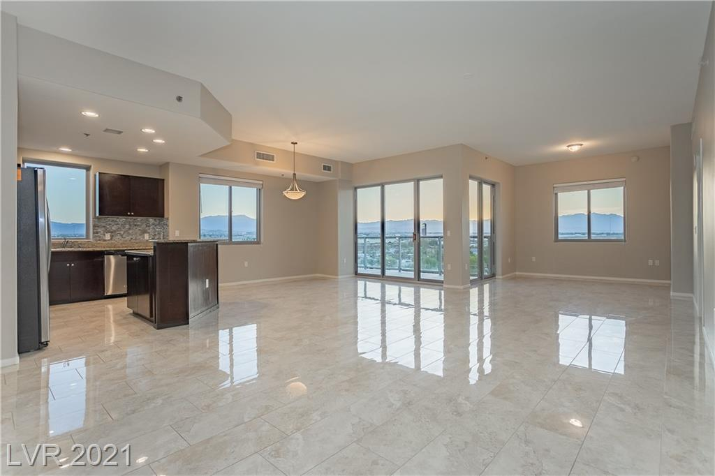 Take in breathtaking expansive views of the Las Vegas Strip and Mountains from this spacious 2 bedroom 2.5 bath plus den home. This home boasts an open concept layout with plenty of space to accommodate all of your furniture. The large great room features a den, perfect for a home office, media room, or sitting area with access to a private wrap around balcony. Kitchen features granite countertops with breakfast bar and stainless steel appliances. Primary suite features private balcony, two walk-in closets. Temp controlled storage unit included, and 2 parking spaces. Prime location on South Strip; mins from Allegiant Stadium, McCarran & I-15. Walk to Smith's, CVS, Starbucks & more. Resort living: 24 hr. amenities, 2 story fitness center, resort pool, business center w/conference room, controlled access, 2 dog parks & more. Fannie Mae & VA approved community.