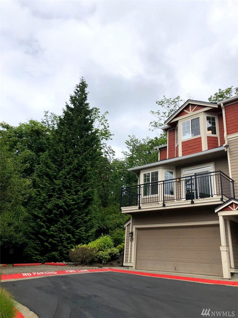 Beautiful, totally remodeled townhome located with easy access to Factoria, Seattle, hwys, parks, Eastgate Pk & Rd. 4 bed, 2.25 bath, 2 car garage, private yard. New floors, new paint, new custom kitchen w/new appliances. Living room w/gas fireplace, outdoor access. New lighting fixtures. Kitchen w/eating space and balcony. One owner, well loved home. Must see!