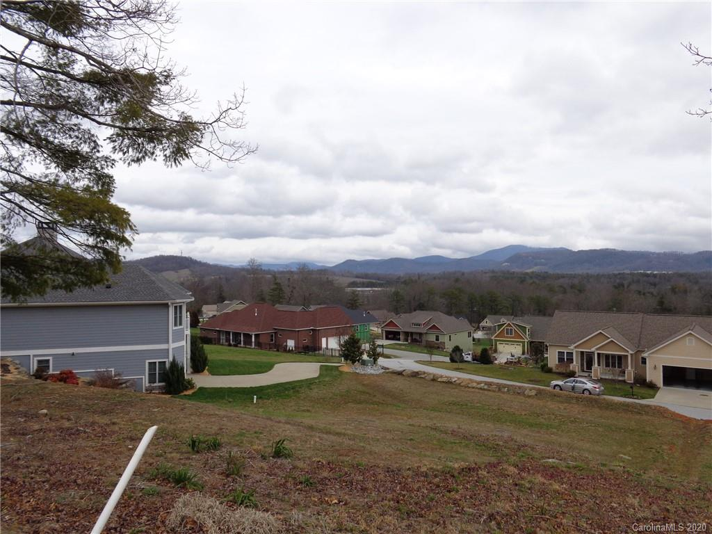 Outstanding home site now available in Phase I @ Blacksmith Run. 180 degree mountain views in this quiet gated community located just 15 minutes to historic DT Hendersonville and only 30 minutes to DT Asheville. Community amenities include gated entrance, community pool and clubhouse w/fitness room, pond and walking trail..Craftsman style home plans from 1200 to over 3000 sq. ft available. .25 Acre home site.