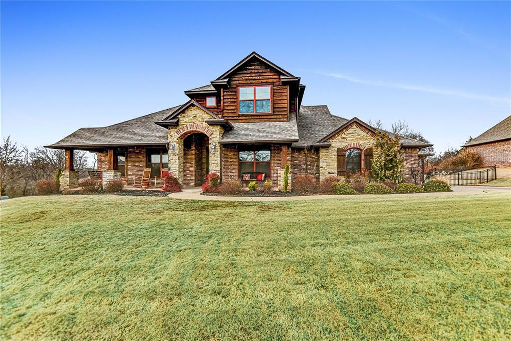 This Edmond home is breath taking! The gorgeous exterior features stone and wood details and a covered front porch and back patio. Back patio is spacious enough for plenty of outdoor furniture and features an outdoor fire place with a mantle and hookups for a TV. Inside you will find a sprawling open floor plan. Living room showcases large windows and a beautiful fireplace with built-ins on either side. The large kitchen opens up to the living and dining space and is decorated by stylish brick details, tons of cabinet space, and granite countertops. Master bedroom includes an oversized en suite with his and her vanities and a corner soaking tub. This floor plan is completed by 3 secondary bedrooms, a bonus room, and a formal study! Huge utility room with counter and cabinet space as well as tons of storage through out the home. Sitting in a desirable community, this home can't be beat!